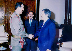 [Hussein greets Massoud Rajavi]